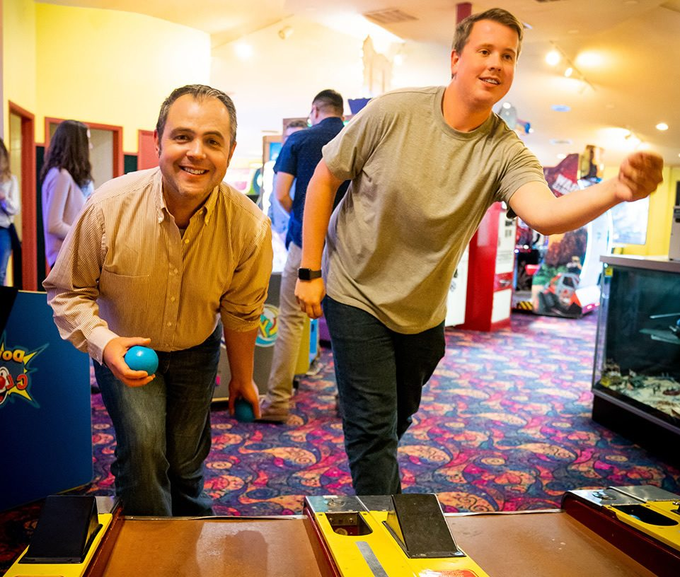 Guys having fun at an arcade